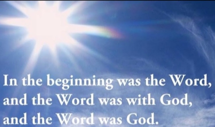 "Picture of the Sun in a blue sky with the text, ""In the beginning was the Word, and the Word was with God, and the Word was God."""