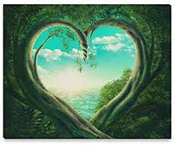 The image is a blue, partly cloudy sky over an ocean looking through a vine wall. The opening is in the shape of a heart.