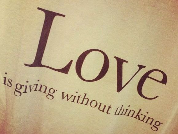 """Brown background with the text """"LOVE is giving without thinking"""""""